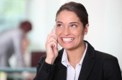 Businesswoman on the phone smiling.