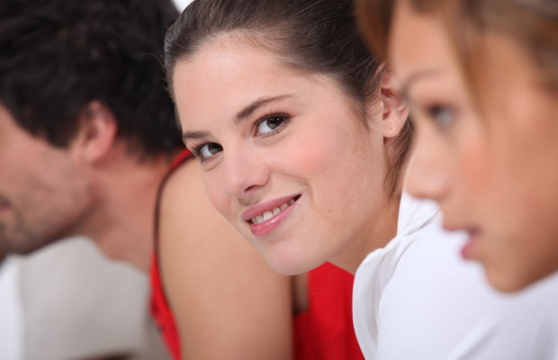 Smiling woman among a group of people