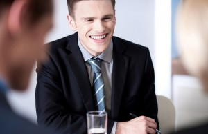 Cheerful businessman laughing in meeting