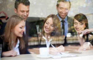 Group of business people in coffee shop